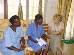 Dr. Diamond discusses a case with two members of the Naggalama Hospital staff in Uganda.
